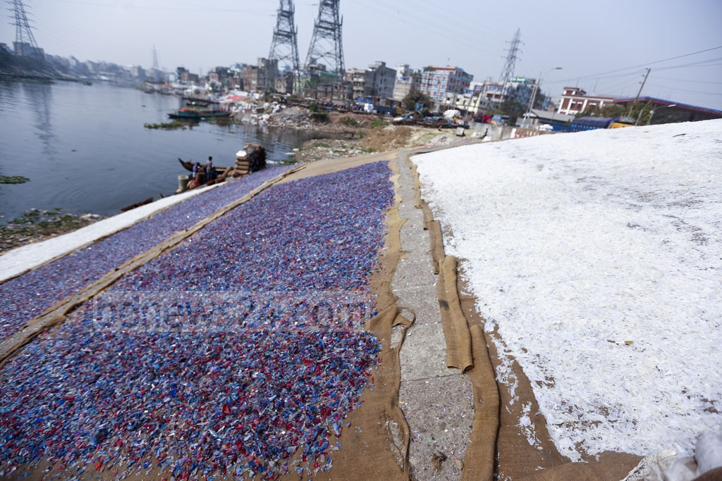 The plastic waste from different parts of the capital are sorted on the basis of colour before being cut to pieces for reuse. Photo: Mahmud Zaman Ovi