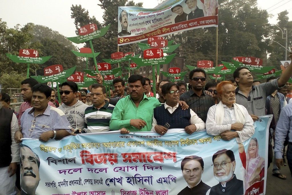 Awami League activists celebrate the party's landslide victory in the 11th national parliamentary election on their way to a rally at Suhrawardy Udyan on Saturday. Photo: Asif Mahmud Ove