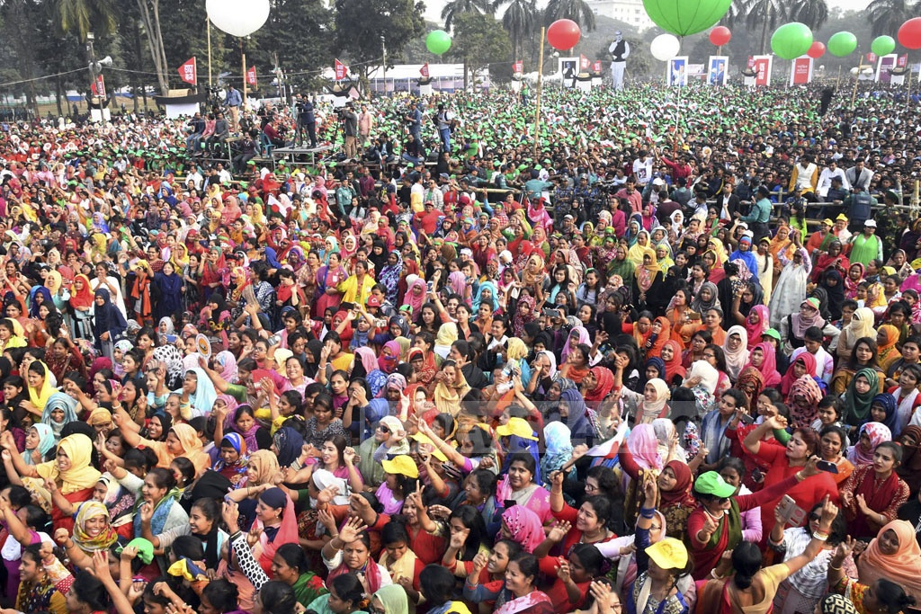 Awami League leaders, activists and supporters swarm the Suhrawardy Udyan on Saturday to celebrate the party's landslide victory in the 11th national parliamentary elections. Photo: PID