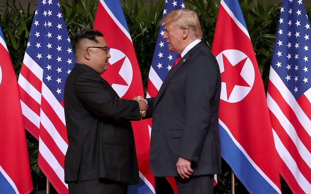 FILE PHOTO - US President Donald Trump shakes hands with North Korean leader Kim Jong Un at the Capella Hotel on Sentosa island in Singapore Jun 12, 2018. REUTERS/Jonathan Ernst/File Photo