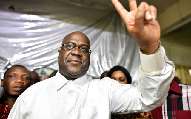 Felix Tshisekedi, leader of the Congolese main opposition party, the Union for Democracy and Social Progress who was announced as the winner of the presidential elections gestures to his supporters at the party headquarters in Kinshasa, Democratic Republic of Congo, Jan 10, 2019. REUTERS