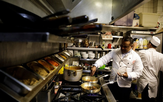 Abdul Ahad, owner of the City Spice curry house, cooks a vegan meal in the kitchen of his restaurant on Brick Lane in London, Britain Jan 7, 2019.