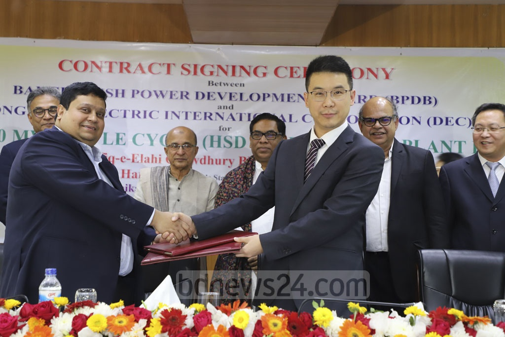 An agreement to set up a 150MW power station in Nilphamari's Syedpur is signed between Bangladesh Power Development Board and Chinese firm Dongfang Electric International Corporation on Tuesday. Photo: Abdullah Al Momin