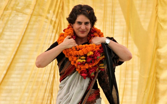 FILE PHOTO: Priyanka Gandhi Vadra, daughter of India's ruling Congress party chief Sonia Gandhi, adjusts her flower garlands as she campaigns for her mother during an election meeting at Rae Bareli in the northern Indian state of Uttar Pradesh April 22, 2014. REUTERS/Pawan Kumar/File Photo