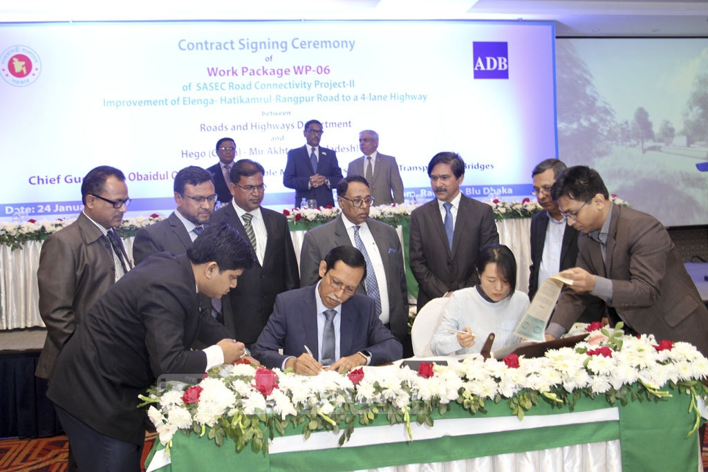 Representatives of the Roads and Highways Department and China's Hego sign a contract at the Radisson hotel in Dhaka on Thursday to upgrade the road from Elenga to Rangpur to four lanes. Photo: Asif Mahmud Ove