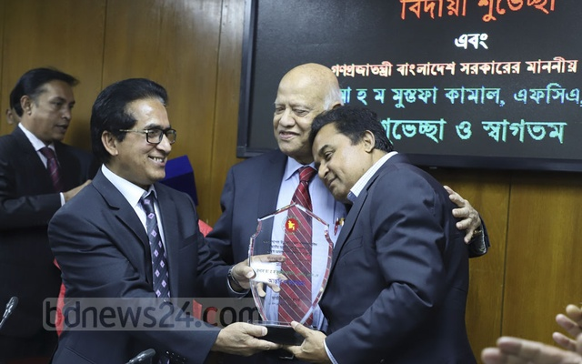 AHM Mustafa Kamal and Abul Maal Abdul Muhith share a rare moment at a ceremony at the National Board of Revenue on Thursday. Photo: Abdullah Al Momin