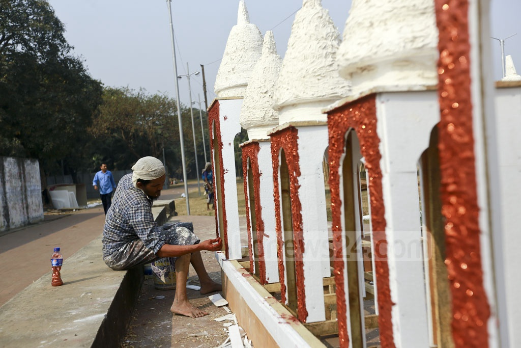 A worker paints installations for book stalls at Suhrawardy Udyan ahead of the annual Amar Ekushey Book Fair. Photo: Mahmud Zaman Ovi