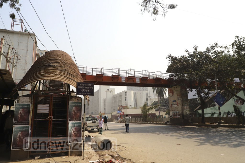 Workers dismantling the footbridge in front of the National Press Club in Dhaka to make way for the metro rail project on Friday. Photo: Abdullah Al Momin