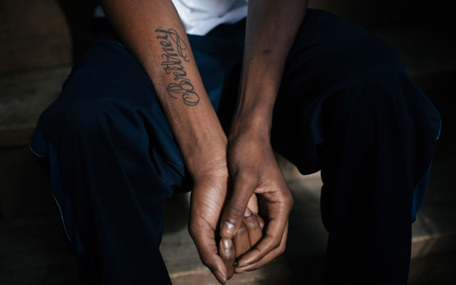 Brandon Williams, whose sister died in 2015 from complications with sickle-cell disease, shows a tattoo of her name, in Chicago, Dec 19, 2018. The New York Times