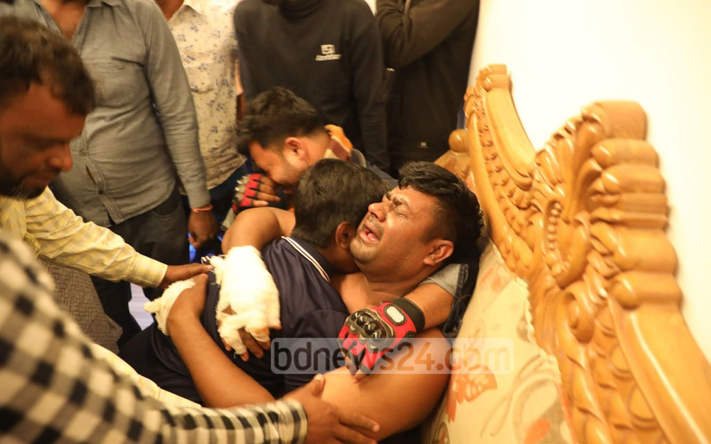 The parents of two children killed in a truck accident on Monday in Dhaka's South Keraniganj break down in tears. Photo: Abdullah Al Momin