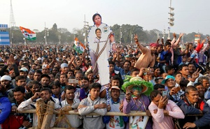 A supporter holds a cut-out of Mamata Banerjee, Chief Minister of the state of West Bengal, during