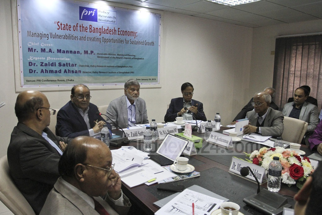 Planning Minister MA Mannan speaking at a Policy Research Institute discussion, 'State of Bangladesh Economy: Managing Vulnerabilities and Creating Opportunities for Sustainable Growth', in Dhaka on Tuesday.