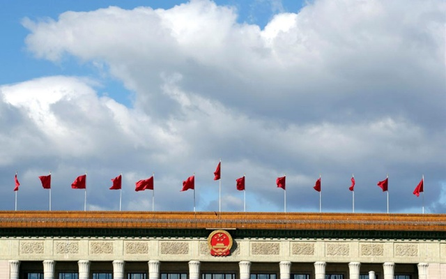 Red flags flutter on the top of the Great Hall of the People in Beijing, China Sept 30, 2018. REUTERS
