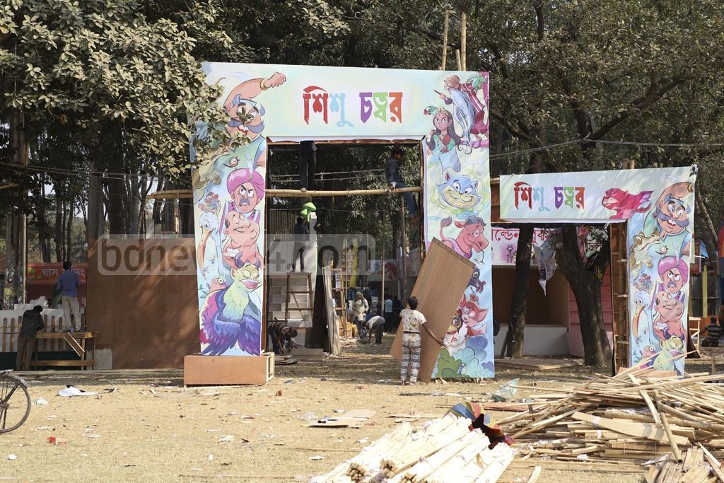 The month-long Ekushey Book Fair is a day away. The last-minute preparation is going on. Photo: Abdullah Al Momin