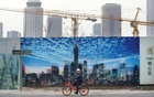 A man cycles outside the construction sites in Beijing's central business area, China Jan 18, 2019. REUTERS