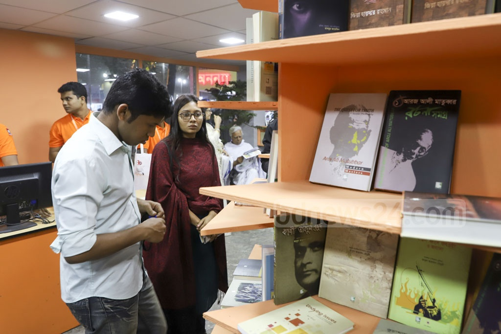 Book lovers checking the stalls at the Amar Ekushey Book Fair in Dhaka on the opening day on Friday. Photo: Abdullah Al Momin