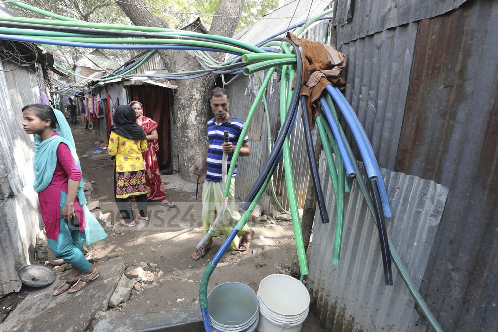 No WASA water lines are at the Korail slum in Dhaka's Mohakhali. Residents make do with water from these plastic pipes and have to pay Tk 600 per month. Photo: abdul mannan