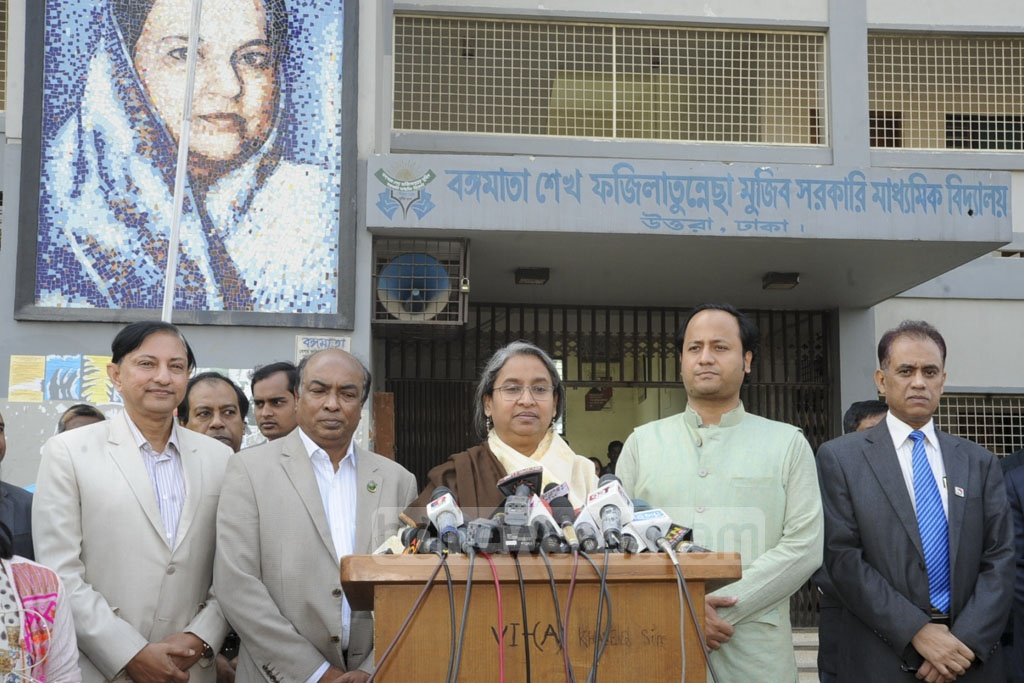 Education Minister Dipu Moni speaks to the media after inspecting the Sheikh Fazilatunnesa Mujib Government Secondary School examination centre in Dhaka's Ashkona on the first day of the SSC exams.
