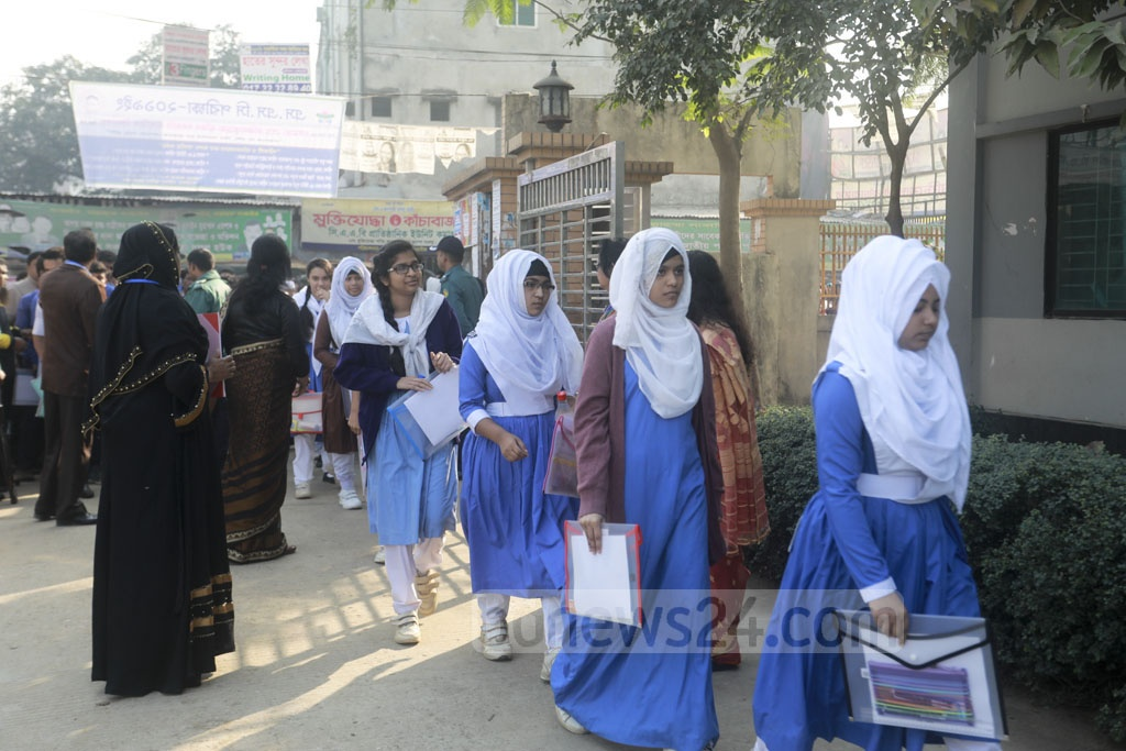 Students enter an examination centre ahead of the SSC exams on Saturday.