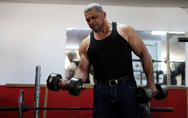 Ibrahim al-Masri, trains at a gym, on his last day as the chief muezzin of the Al-Jazzar Mosque, in Acre, northern Israel January 31, 2019. Reuters