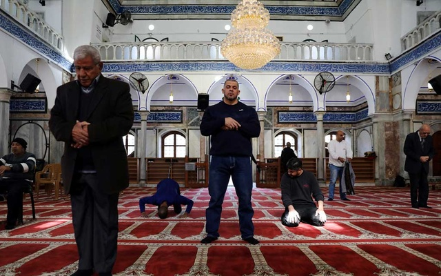 Ibrahim al-Masri, prays inside the Al-Jazzar Mosque on his last day as the chief muezzin of the mosque, in Acre, northern Israel January 31, 2019. Reuters