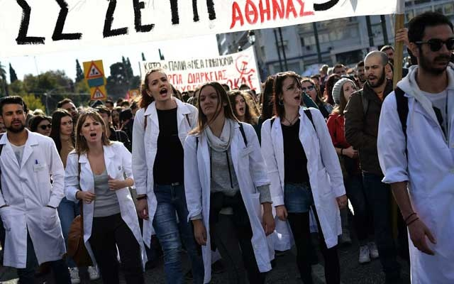 Health workers during a general strike in Athens in 2017. Annual state spending on mental health was halved in 2012, and it has been trimmed further each year since then. The New York Times