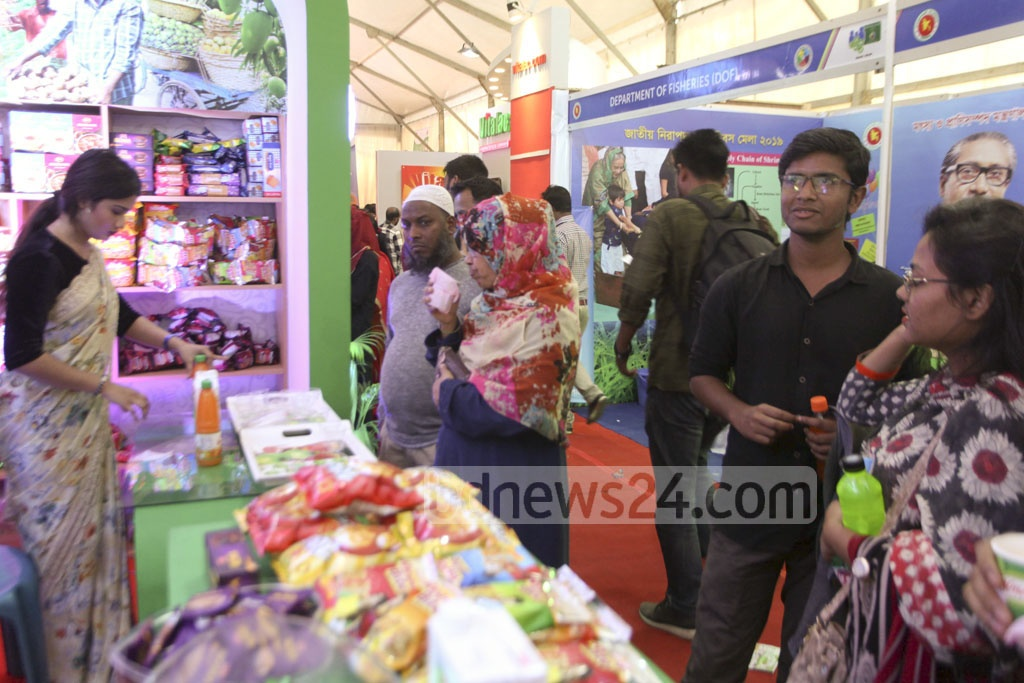 Visitors check products at a stall at a food exhibition marking the National Food Safety Day at the Krishibid Institute in Dhaka on Monday.