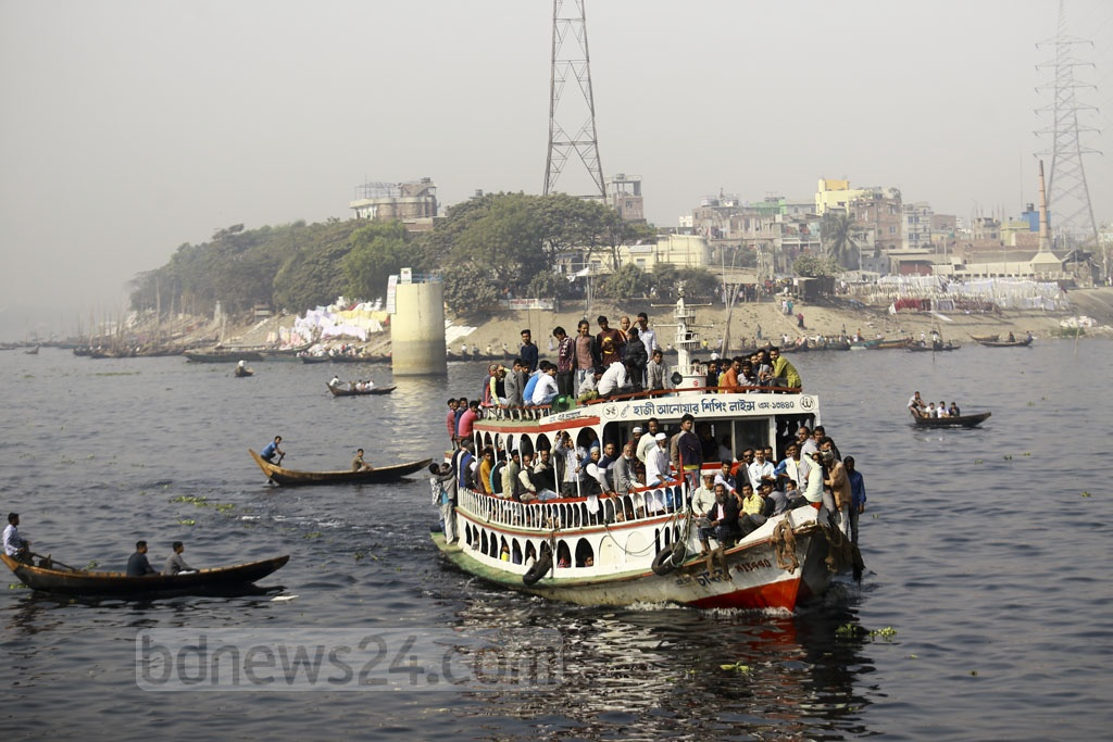 Many cross the Buriganga River by launch every day. This photo of the river with dark, polluted water was taken at Kamrangirchar in Dhaka on Tuesday. Photo: Mahmud Zaman Ovi