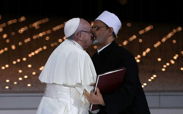 Pope Francis and Grand Imam of al-Azhar Sheikh Ahmed al-Tayeb kiss each other after signing a document on fighting extremism, during an inter-religious meeting at the Founder's Memorial in Abu Dhabi, United Arab Emirates, February 4, 2019. Reuters