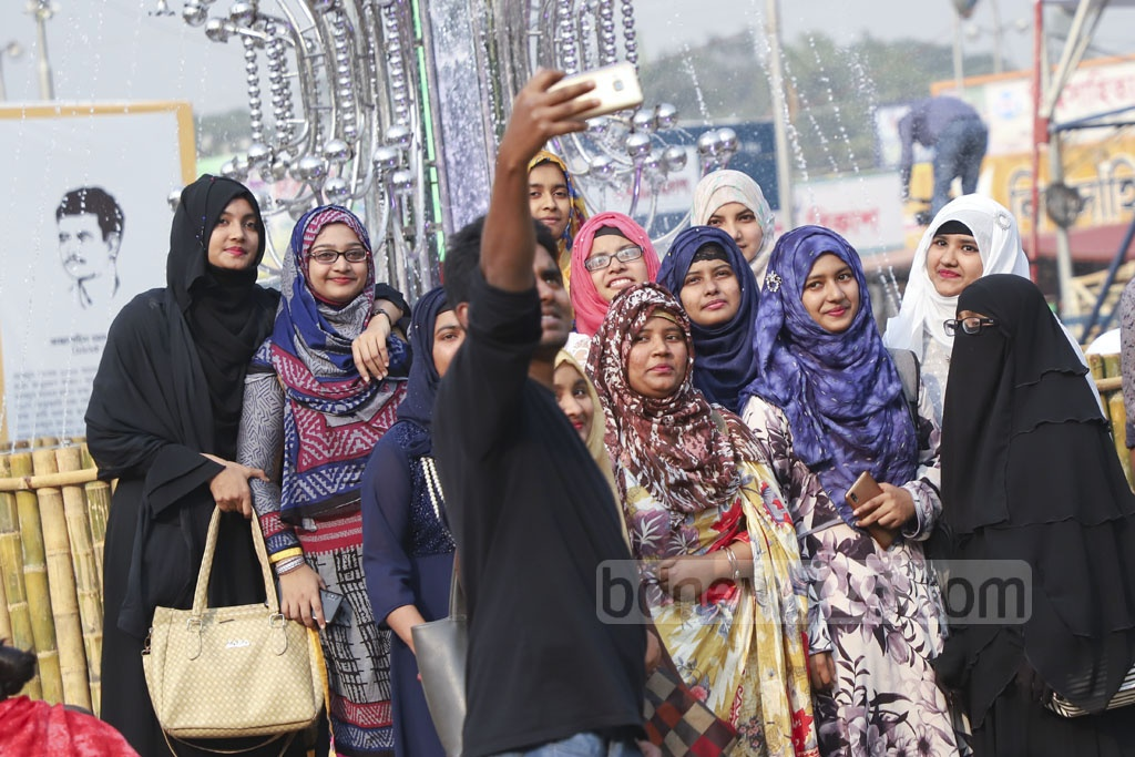 Along with the nature, the Amar Ekushey Book Fair took a colourful look on Thursday to welcome Falgun, the first month of Basanta or spring in Bangla calendar, which is only a week away. Many of the girls and young women at the fair were seen with floral headbands. Photo: Abdullah Al Momin