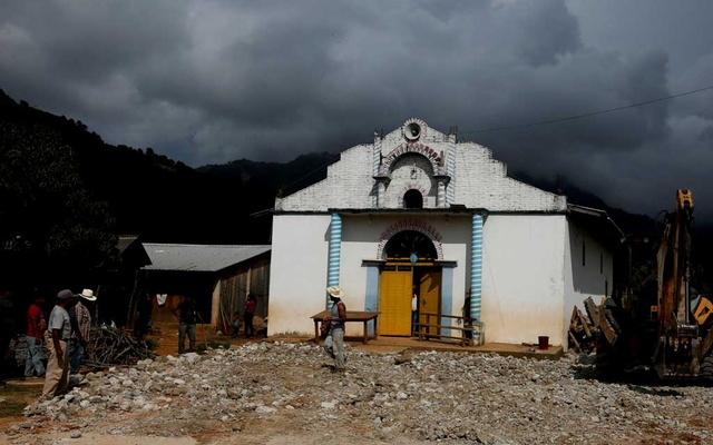 A man walks in front of a local church of Santa Cruz Yucucani in the Sierra Madre del Sur, in the southern state of Guerrero, Mexico, August 17, 2018. REUTERS/Carlos Jasso