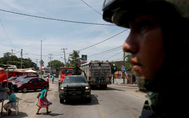 Soldiers patrol the area on their way to the Sierra Madre del Sur, in the southern state of Guerrero, Mexico, August 24, 2018. REUTERS/Carlos Jasso