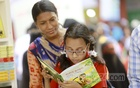 Choosing books at stalls during Shishu Prohor or Children's Hour in book fair. Photo: Mahmud Zaman Ovi