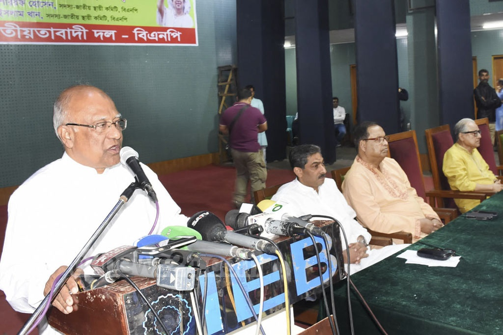BNP Standing Committee Member Khandaker Mosharraf Hossain speaking at a meeting organised at the IEB Auditorium in Dhaka on Friday demanding release of all leaders and activists, including their chief Khaleda Zia. The BNP chairperson was put into jail a year ago on this day.