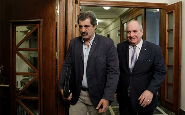 Greek Deputy Health Minister Pavlos Polakis (L) and Greek Deputy Minister of Foreign Affairs Terens Quick arrive for a cabinet meeting at the parliament in Athens, Greece July 19, 2017. Reuters