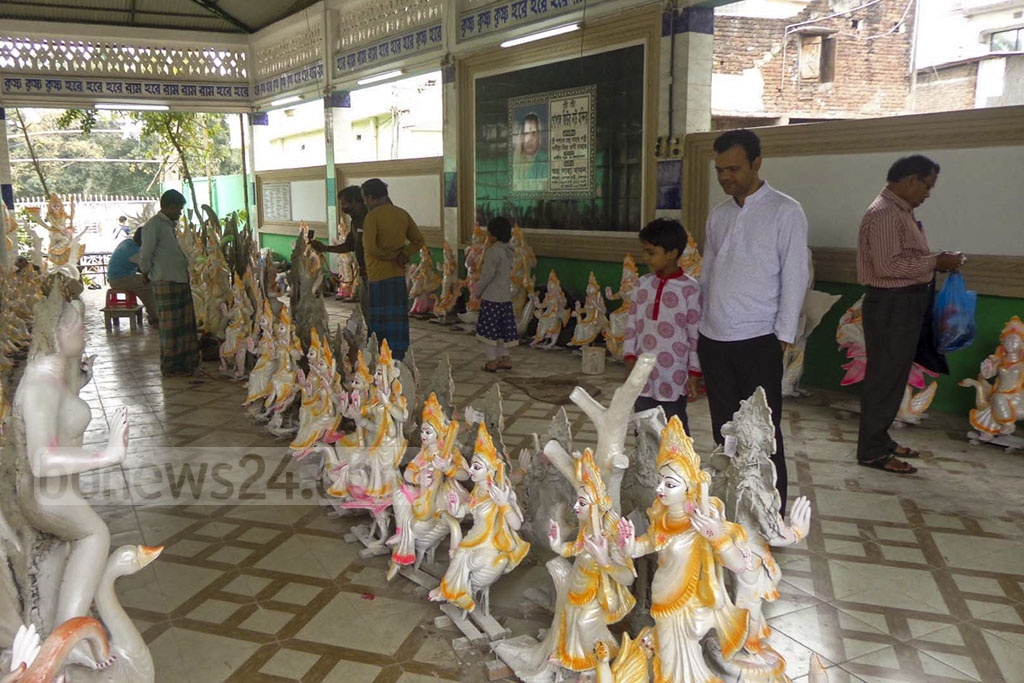 Statues for sale are on display at the Gopal Jiu Nath Temple in Sherpur for Saraswati Puja.