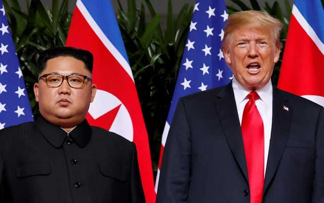 FILE PHOTO: US President Donald Trump and North Korean leader Kim Jong Un react at the Capella Hotel on Sentosa island in Singapore Jun 12, 2018. REUTERS/Jonathan Ernst/File Photo