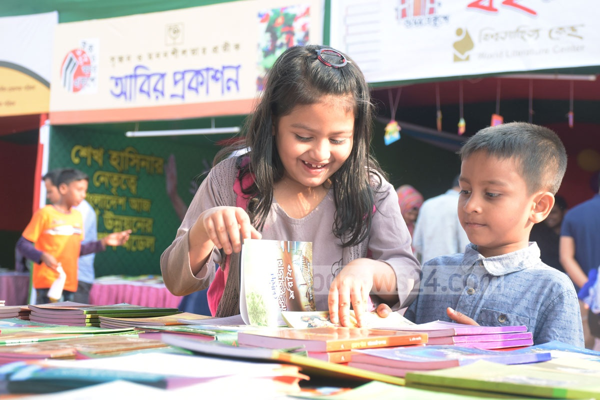 Visitors browsing the stalls at the Amar Ekushey Book Fair organised by the Chattogram City Corporation at MA Aziz Stadium area in the port city on Sunday. Photo: Suman Babu