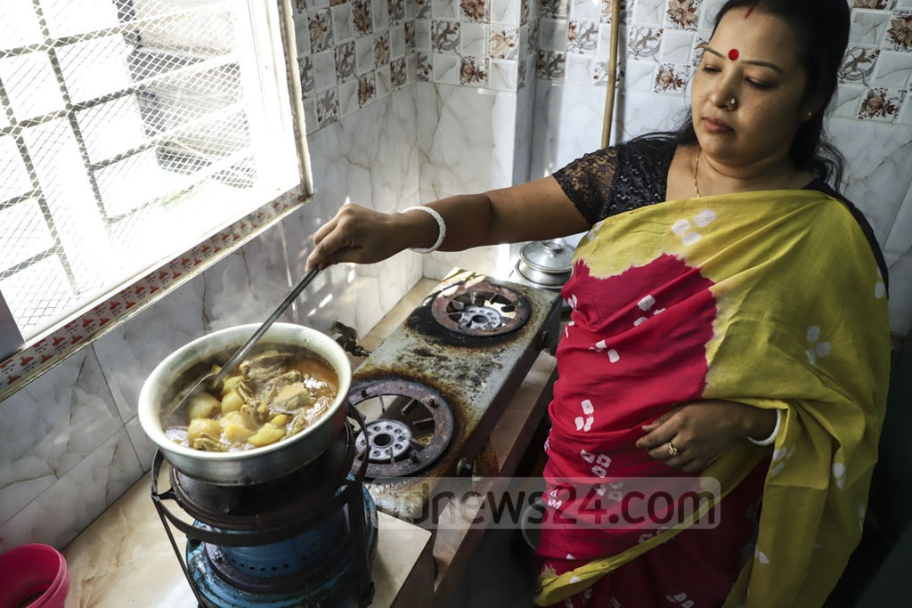 A woman using a kerosene stove for cooking on Prasanna Poddar Lane at Tantibazar in Old Dhaka on Sunday due to a crisis of gas. Photo: Abdullah Al Momin
