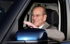 FILE PHOTO: Britain's Prince Philip is driven away from Papworth Hospital in southern England Dec 27, 2011. REUTERS/Neil Hall/File Photo
