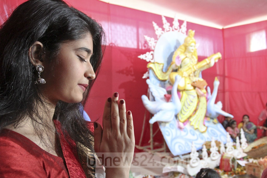 A student prays to Saraswati, the goddess of learning, at Dhaka University's Jagannath Hall on Sunday. Photo: Asif Mahmud Ove