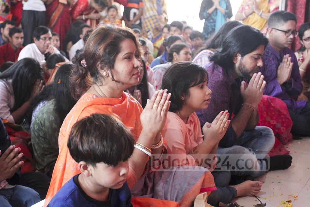 Devotees pray at the puja grounds at Dhaka University's Jagannath Hall. Photo: Asif Mahmud Ove
