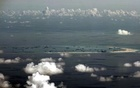 US destroyers sail in disputed South China Sea amid trade tensions