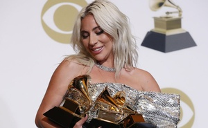 Lady Gaga poses backstage with her awards for Best Song Written for Visual Media and Best Pop Duo/Group Performance for