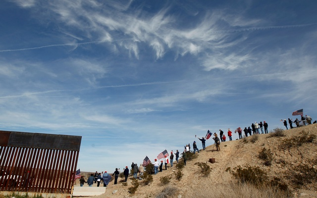 US demonstrators holding US flags gather at the open border to make a human wall in support of the construction of the new border wall between US and Mexico, in Ciudad Juarez, Mexico February 9, 2019. REUTERS
