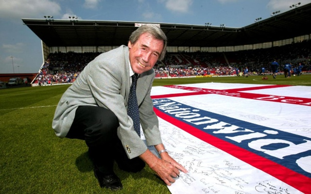 FILE PHOTO: Giant Nationwide flag which is being signed by Gordon Banks for England during Euro 2004. Aldershot Town v Shrewsbury Town - Nationwide Conference Play Off Final - Britannia Stadium , 16/5/04. Action Images/Michael Regan via Reuters