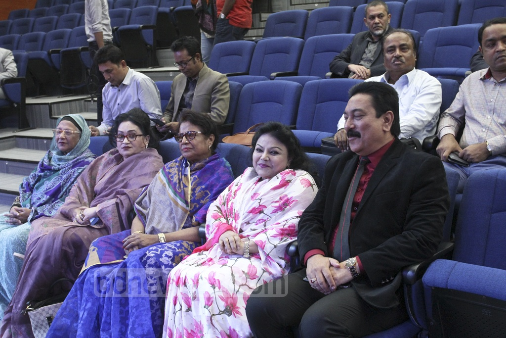 Jatiya Party Secretary General Mashiur Rahman Ranga seated with the party's four reserved seat nominees to an Election Commission programme to verify nomination documents on Tuesday. Photo: Asif Mahmud Ove