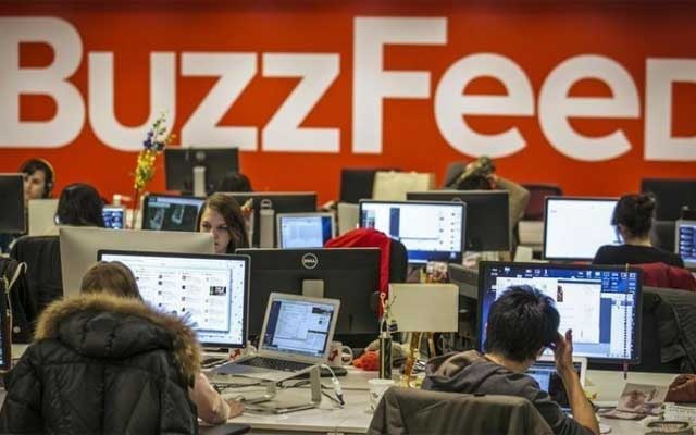 Buzzfeed employees work at the company's headquarters in New York Jan 9, 2014. REUTERS