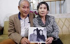 Former Vietnamese chemical student Pham Ngoc Canh who studied in North Korea and his North Korean wife Ri Yong Hui hold their first photo together which was taken in Spring 1971, at their house in Hanoi, Vietnam Feb 12, 2019. REUTERS/Kham