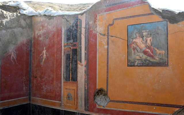 An undated photo of the atrium of a house with a fresco portraying the mythological hunter Narcissus, right, in Pompeii, near Naples, Italy. The New York Times